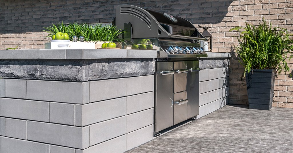 U-Cara™ Modular System-Grill Island with Smooth Premier fascia panels in Opal and Pitched fascia panels in Granite Fusion